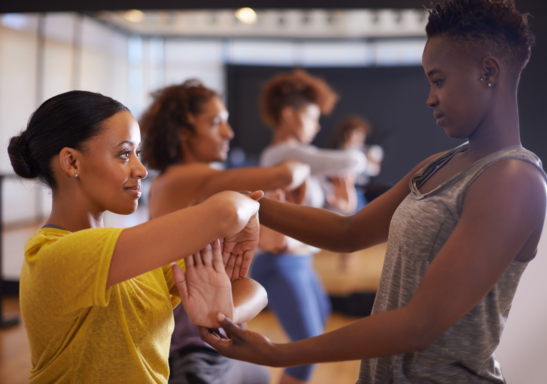 Shot of a group of people practicing in a dance studio